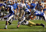 Jackets DB Dominique Reese dives to try to stop Blue Raiders RB D.D. Kyles
