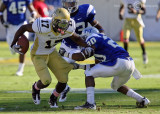Jackets A-back Orwin Smith moves to escape Blue Raiders S Kellem…
