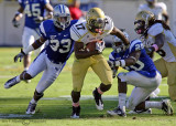 …Yellow Jackets A-back Smith breaks away from Blue Raiders S Kevin Brown