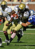 Jackets B-back Allen fights off the tackle of Blue Raiders LB Corey Carmichael