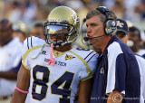 Georgia Tech Yellow Jackets Head Coach Paul Johnson delivers the next play to WR Tyler Melton
