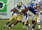 Jackets QB David Sims tries to outrun the Blue Raiders defensive line