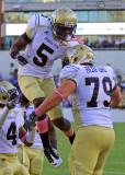 Yellow Jackets WR Stephen Hill celebrates a touchdown catch with C Sean Bedford