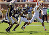 …Jackets defenders force Miami QB Morris to throw on the run