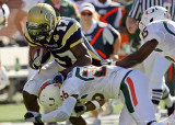 Georgia Tech A-back Smith fights off Miami DB Ray-Ray Armstrong