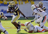 Yellow Jackets B-back Allen slips out of the grasp of Hurricanes LB Colin McCarthy…