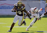 …Georgia Tech B-back Allen gains extra yardage getting past Miami DB Armstrong