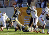 Yellow Jackets QB Washington throws over Canes DL Marcus Forston