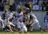 Georgia Tech DT TJ Barnes gets a hand up in an effort to block the PAT attempt by Miami PK Matt Bosher