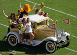 Georgia Tech Cheerleaders and Buzz ride the Ramblin' Wreck onto the field before the second half kickoff