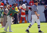 Miami Hurricanes Head Coach Randy Shannon has a discussion with the referee