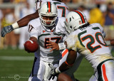 Hurricanes QB Morris hands off to RB Berry