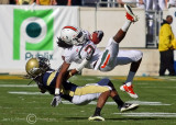 Jackets CB Mario Butler pulls down Canes WR Travis Benjamin after an acrobatic catch