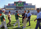 Georgia Tech Yellow Jackets Head Coach Paul Johnson meets Miami Hurricanes Head Coach Randy Shannon at mid-field after the game