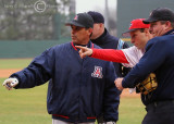 Arizona Coach Andy Lopez and the umpires get a rundown of the ground rules from Georgia Coach David Perno