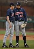 Cats 1b Ziegler talks to starting pitcher Preston Guilmet between batters