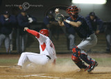 Cats C Childs looks to throw as Bulldogs RF Olson slides home