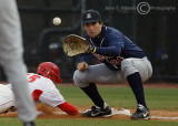 Wildcats 1B Ziegler takes the pick-off throw as Bulldogs 2B Demperio dives back safely