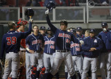 Arizona 1B Ziegler celebrates at home with teammates after hitting a home run
