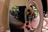 Reflection of 1931 Auburn in '36 Cord Hubcap