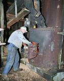 Gene feeding the boiler --------- IMG_0844a.jpg