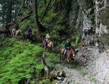 Heading back under the falls (Goat Creek Trail)