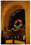 This is a poor shot of the holiday wreath hanging above the east archway.