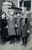 Shown are three of the Merrill children born to, LeRoy Charles Merrill & his wife, Dorothy Mae [Bishop] Merrill. Shown left from right are Dorothy Mae Merrill, unknown childhood friend, Hazel Alice Merrill & their brother, Verne Floyd Merrill