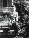 This is a shot of my grandmother's sister, standing outside of her childhood home at 658 South 19th Street, Lincoln Nebraska. Now it serves as the location of a multilevel apartment building.