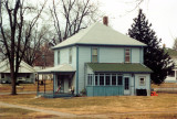 Another view of the house. In 2008, it was painted grey, with a double car garage on the property.