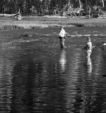 Men fishing in river