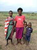 Masai Family- Check out the kid sticking his tongue out!