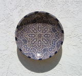 Plate on Courtyard Wall at Cezar and Merrie's House
