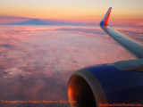 Sunset providing nice colors on the clouds onboard Southwest flight 2380 FLL to BNA aviation sunset stock photo #3787