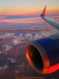 Onboard Southwest flight #2380 with nice sunset colors outside - aviation sunset stock photo #3789