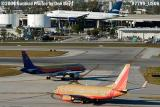 Southwest Airlines B737-7H4 N763SW, Air Jamaica A320 and JetBlue A320 aviation stock photo #7799