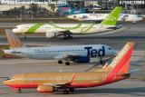 Southwest B737-7H4 N789SW, United Ted A320-232 N470UA, Delta Song B757-232 N640DL, Amerijet B727-233 N994AJ stock photo #7966