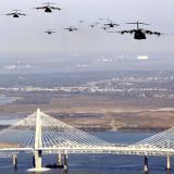 A large formation of USAF C-17 Globemaster IIIs flying over the Arthur Ravenel Bridge in Charleston