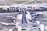 1988 - Concourse E and the E-Satellite at Miami International Airport aerial stock photo