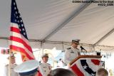 CDR (Captain selectee) Eduardo Pino, CO of CGC GENTIAN (WIX 290) reading the decommissioning order at the ceremony photo #9472