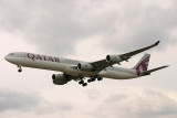 Qatar A-340-600 approaching LHR 27L under gathering clouds