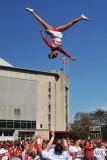 Ohio State University Cheerleader flying high