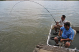 Coy hooks a catfish