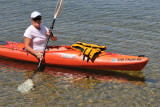 Brenda kayaking on the clear waters of Lake Couchiching