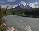 The Bow River near Lake Louise. A glacier is on the mountain in the background