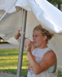 Tracy setting up a display tent
