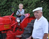 Camden and Great Grandpa with the Massy Harris 30 that he bought 50 years ago