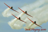T6 Texans of the AeroShell Squadron perform over Oshkosh