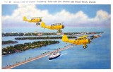 Late 1930's - early 1940's - U. S. Navy N3N Yellow Peril trainer biplanes from NAS Miami over Government Cut, Miami