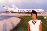 A young European lady with Pan Am aircraft in the background at Miami International Airport
